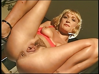 Hot short hair blonde on table fingering pussy stoops and urinates