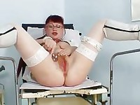 Redhead amateur lady stretching her red hairy puss