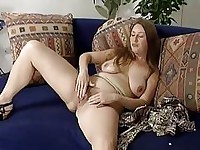 Mature blonde playing with herself