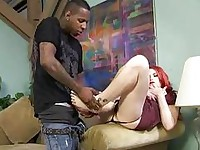 Aurora Rose does footjob on black cock