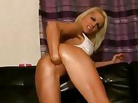 Stunning blond babe fisting both her holes