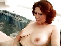 Busty granny gets fisted hard