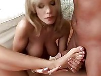 Desirable blonde with great boobs and foot fetish gives footjob