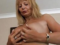 Alex rubbing her tits and fingering her pussy