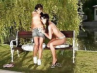Tawnee and Helen brunette lesbian girls undressing and kissing in the park