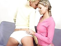 Mia and Iris blonde lesbian couple licking nipples on the couch