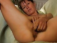 Skinny brunette milf in red undies plays with her hairy twat