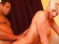 Hot blonde milf with big honkers takes black dick doggy style