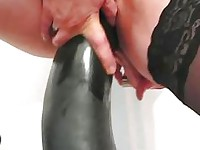Frustrated wife fucking gigantic dildos