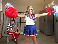 Adorable blonde teen cheerleader talking with her teacher