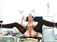 Brunette in nurse uniform plays with her beaver in hospital