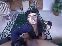 Sexy brunette in a police uniform does hand job and sucks cock