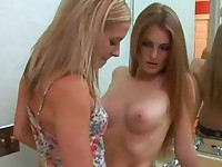 Two teen lesbian fingering and masturbating