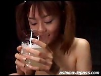 Cute Japanese babe drinks a glass of CUM