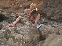 Cute blondie Alice masturbating on beach