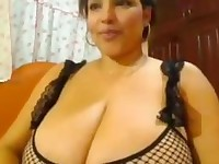 Latin MILF with big breasts and booty teasing