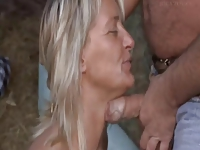 Milf in boots blows the chubby guy in the hay