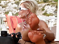 Mature shows her Stocking Feet