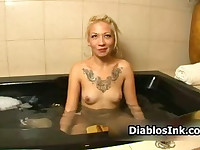 Blonde tattoo chick enjoys getting