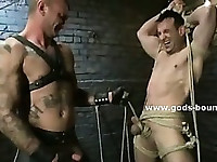 Kinky pervert gay in leather pants enjoys fucking slave locked in cell in extreme bdsm sex video