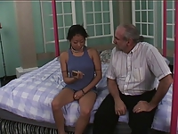 Naughty Asian takes wild spanking in bed