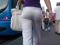 Candid Teen in white yoga pants enters the Tram